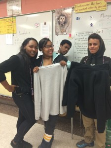 Students in in the New Britain JAG Career Association fold clothing donated through the first annual JAG clothing drive at New Britain High School.
