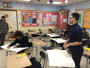 Students begin designing poster to advertise the first annual JAG clothing drive at New Britain High School